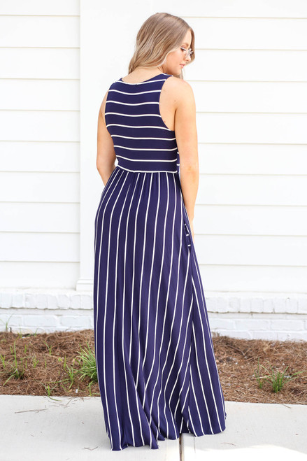 Model wearing Navy and White Striped Empire Maxi Back View