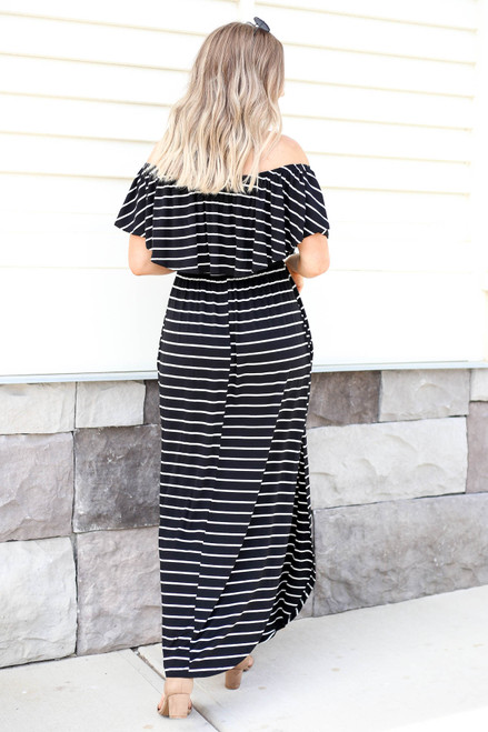 Model wearing Black Striped Off the Shoulder Maxi Dress with Slits Back View