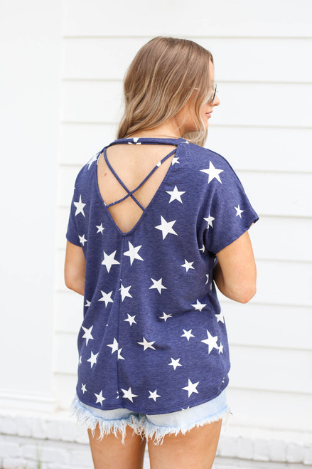 Model wearing Navy Star Print Cross Back Top Back View