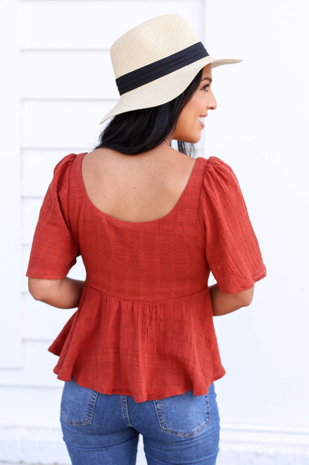Model wearing Rust Button Front Cropped Peplum Top Back View