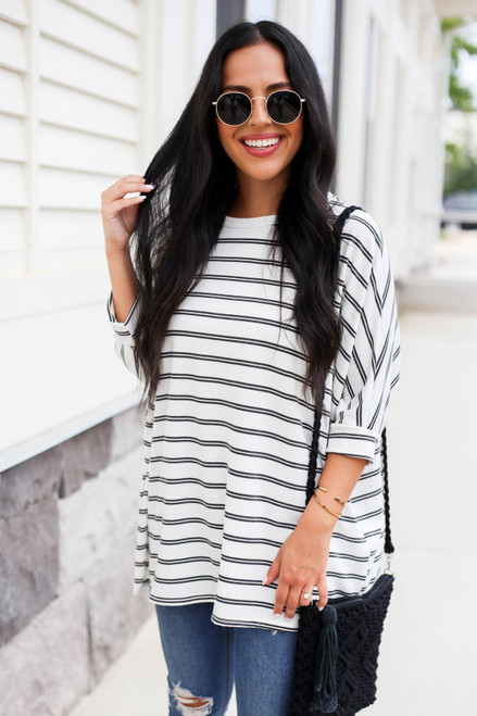 Model wearing Black and White Striped Oversized Top