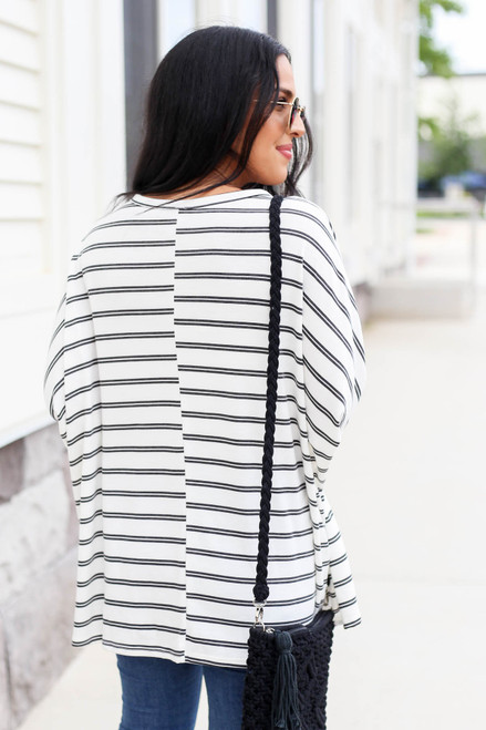 Model wearing Black and White Striped Oversized Top Back View