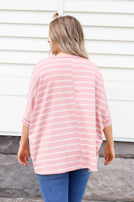 Model wearing Blush and White Striped Oversized Top Back View