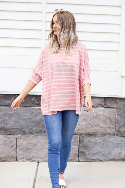 Model wearing Blush and White Striped Oversized Top