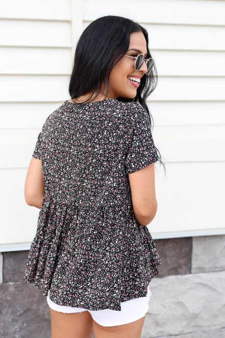 Model wearing Black Floral Print Tiered Blouse Back View