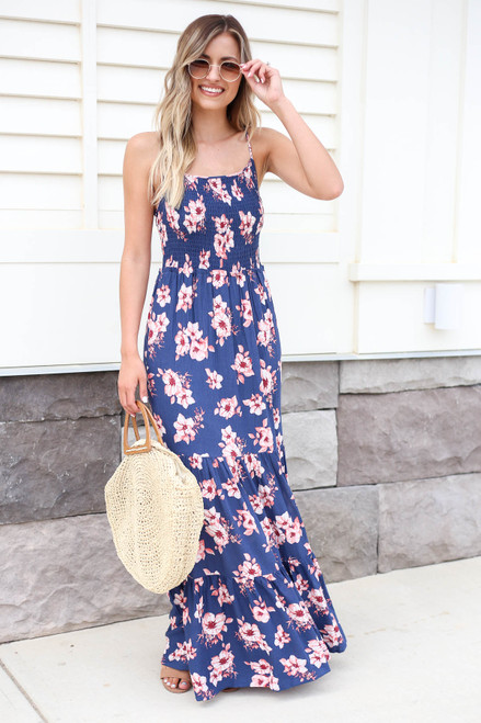 Model wearing Blue Floral Print Smocked Tiered Maxi Dress Front View