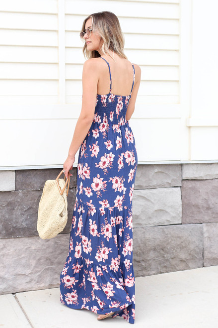 Model wearing Blue Floral Print Smocked Tiered Maxi Dress Back View