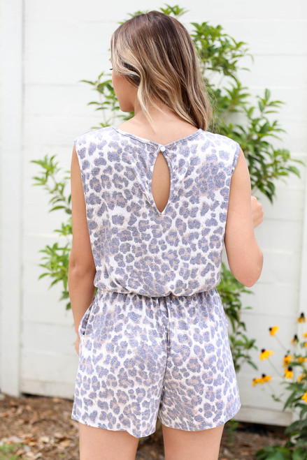 Model wearing  Leopard Sleeveless Criss Cross Romper  Back View
