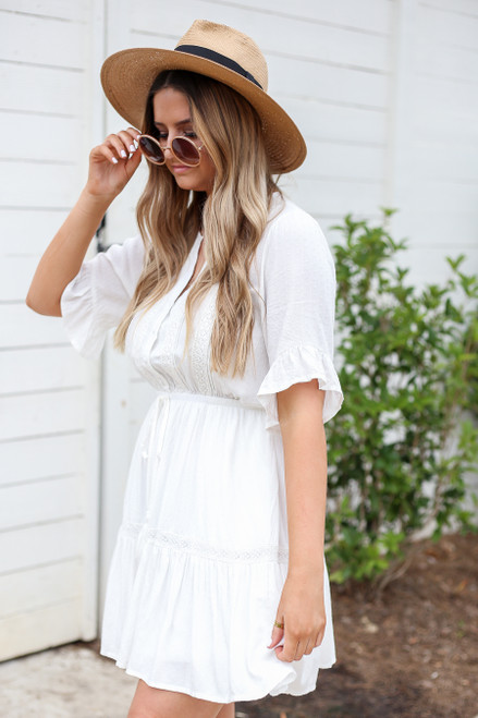 Model wearing White Crochet Ruffle Sleeve Boho Dress Side View
