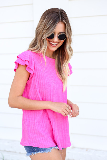 Model wearing Neon Pink Ribbed Ruffle Sleeve Top Front View