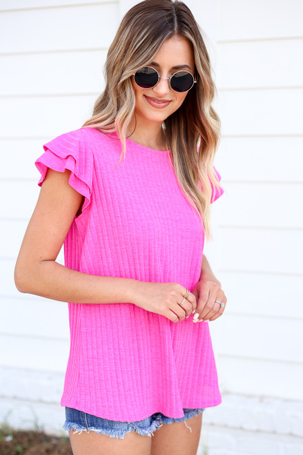 Model wearing Neon Pink Ribbed Ruffle Sleeve Top Side View
