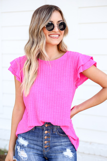 Model wearing Neon Pink Ribbed Ruffle Sleeve Top Front Detail View