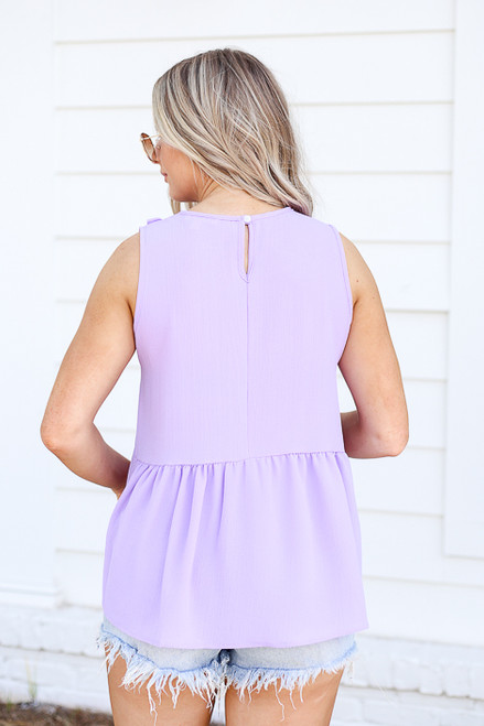 Model wearing Purple Ruffle Front Babydoll Top Back View