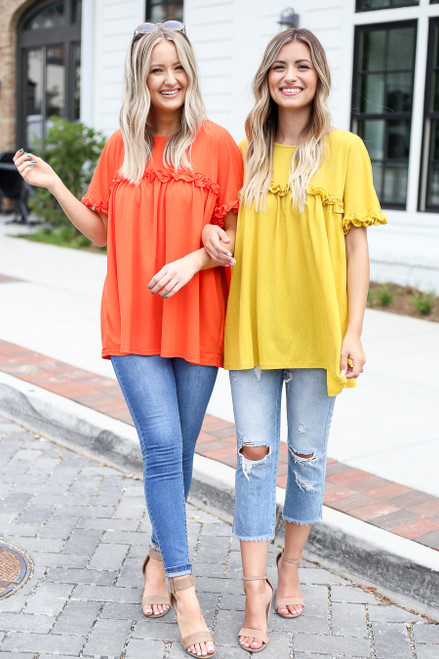 Orange - and Yellow Ruffled Tunics on Models