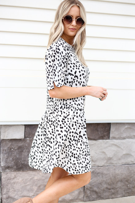 Model wearing White and Black Spotted Ruffle Dress Side View