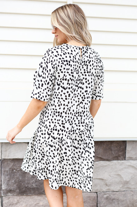 Model wearing White and Black Spotted Ruffle Dress Back View
