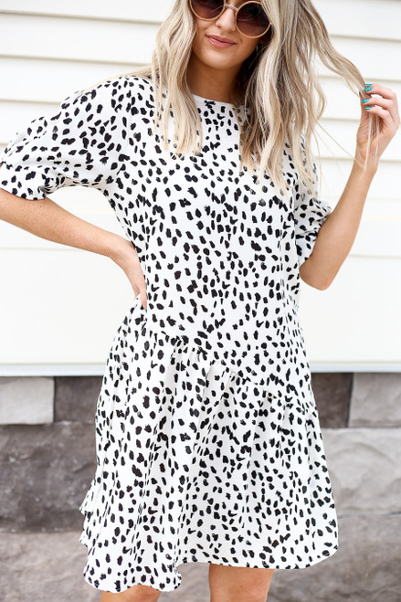 Model wearing White and Black Spotted Ruffle Dress Front View
