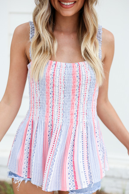 Model wearing Blue and Pink Printed Smocked Tank