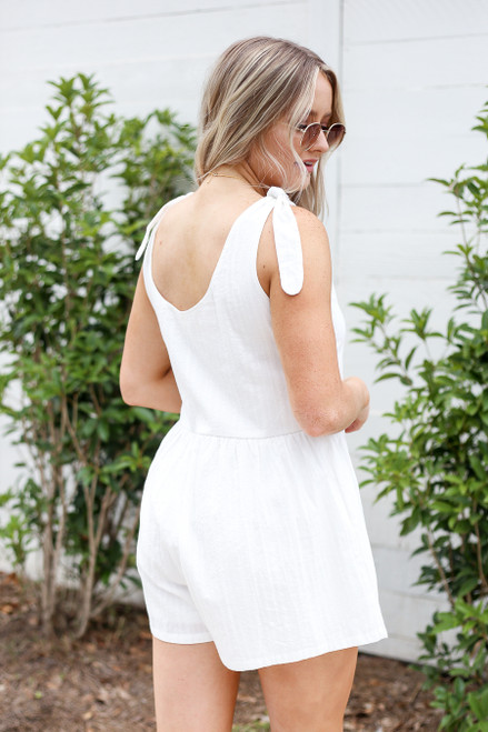 Model wearing White Tie-Strap Pocketed Romper Side View
