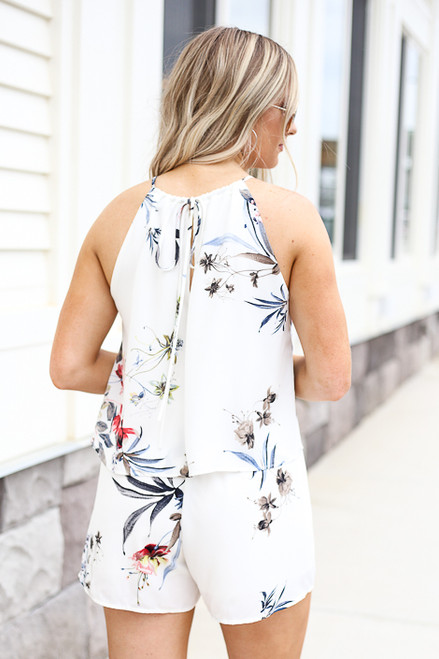 Model wearing Ivory Floral Romper Back View