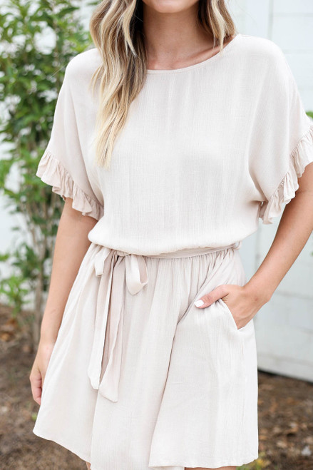Model wearing Taupe Ruffle Sleeve Belted Mini Dress Detail View