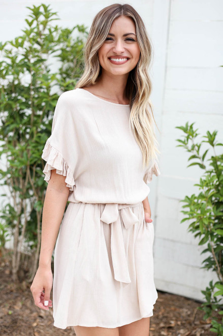 Model wearing Taupe Ruffle Sleeve Belted Mini Dress Side View