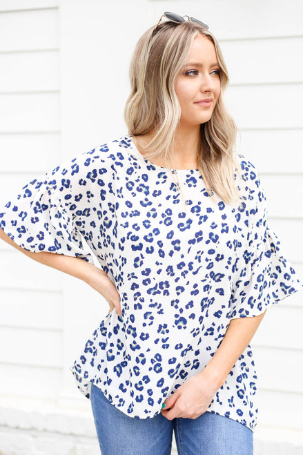 Model wearing White and Blue Leopard Print Ruffle Sleeve Top Front View