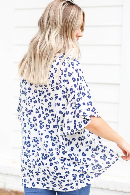 Model wearing White and Blue Leopard Print Ruffle Sleeve Top Back View