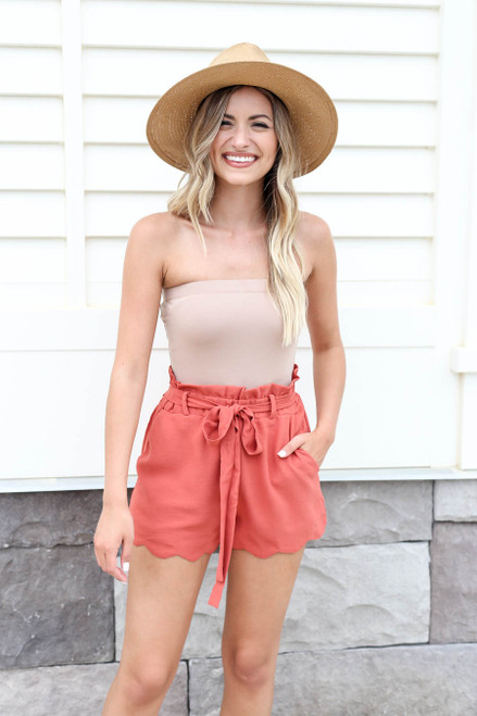 Model wearing Rust Scalloped Belted Shorts Front View