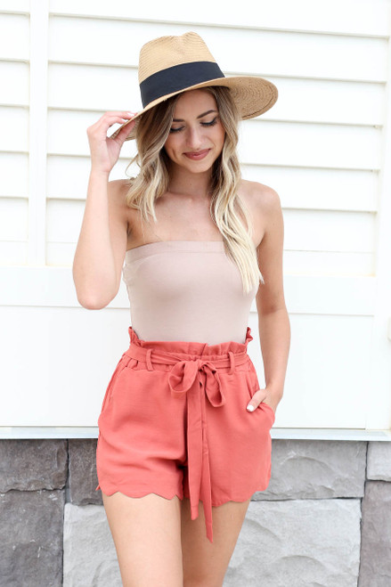 Model wearing Rust Scalloped Belted Shorts