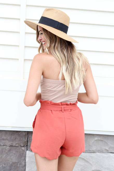 Model wearing Rust Scalloped Belted Shorts Back View