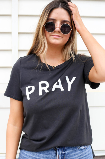 Model wearing Black Pray Graphic Tee Tucked In