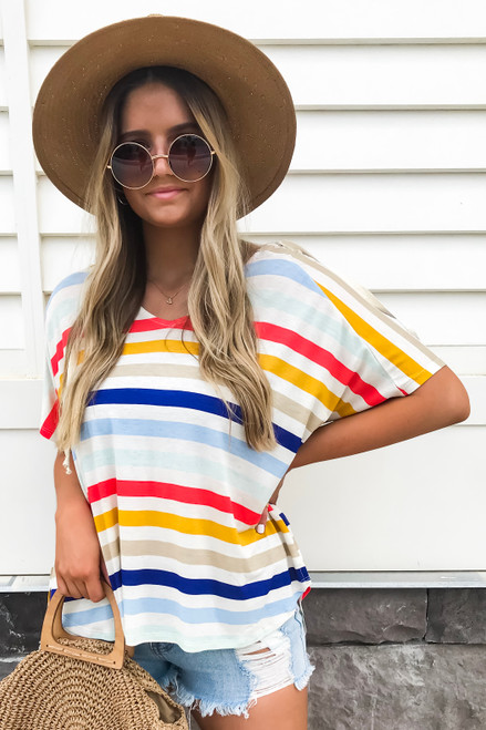 Model wearing Rainbow Striped Hooded Top Side View
