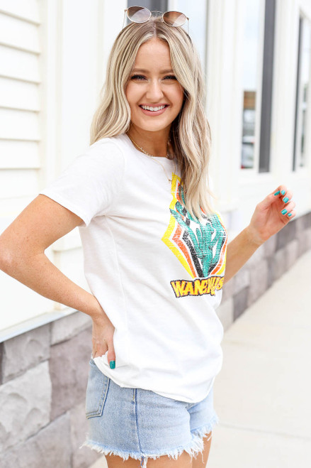 Model wearing Ivory Wanderlust Cactus Graphic Tee Side View