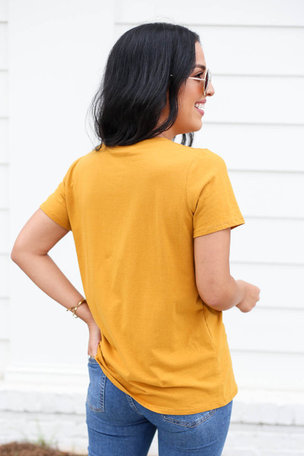 Model wearing Mustard Sunset Graphic Tee Back View