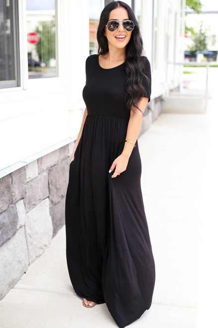 Model wearing Black Criss Cross Back Empire Waist Maxi