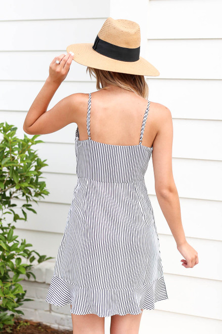 Model wearing Black and White Striped Ruffle Tie Front Mini Dress Back View