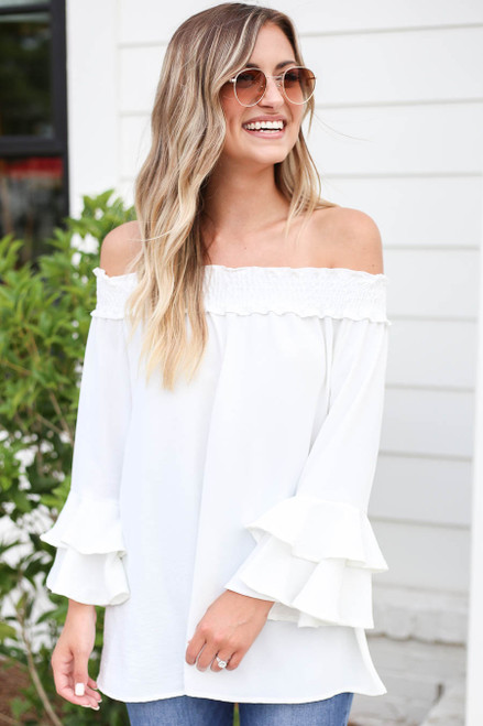 Model wearing White Off the Shoulder Ruffle Sleeve Top Front View