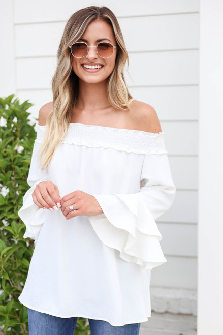 Model wearing White Off the Shoulder Ruffle Sleeve Top