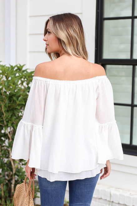 Model wearing White Off the Shoulder Bell Sleeve Top Back View