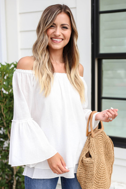 Model wearing White Off the Shoulder Bell Sleeve Top
