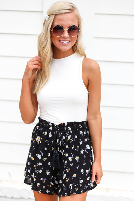 Model wearing Black Ruffled Floral Shorts Front View