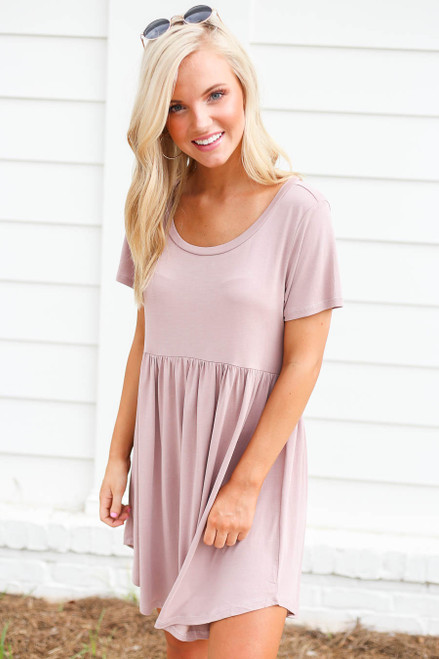 Model wearing Mauve Pocketed Babydoll T-Shirt Dress Front View