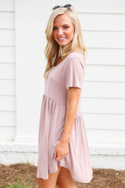 Model wearing Mauve Pocketed Babydoll T-Shirt Dress Side View
