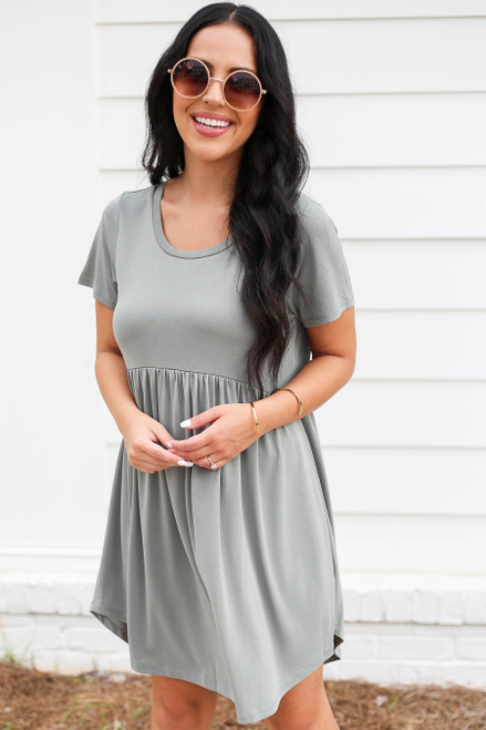 Model wearing Olive Pocketed Babydoll T-Shirt Dress Front View