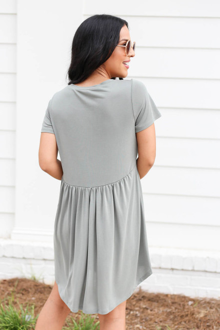 Model wearing Olive Pocketed Babydoll T-Shirt Dress Back View