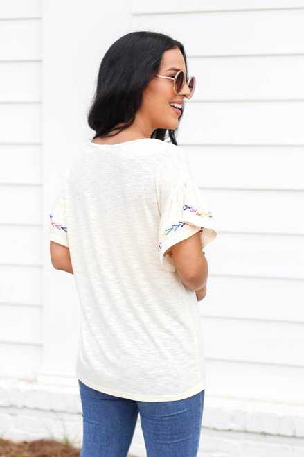 Model wearing Ivory Ruffle Embroidered Sleeve Top Back View