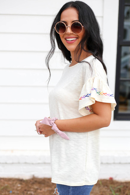 Model wearing Ivory Ruffle Embroidered Sleeve Top Side View
