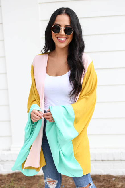 Model wearing Mustard, Mint, and Blush Color Block Wide-Sleeve Kimono Front View