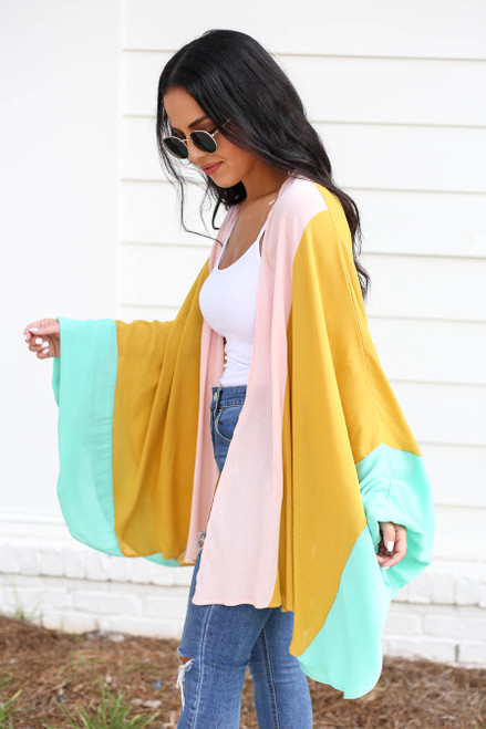 Model wearing Mustard, Mint, and Blush Color Block Wide-Sleeve Kimono